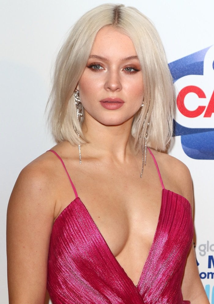 Zara Larsson flaunts her cleavage at Capital's Jingle Bell Ball with Coca-Cola held at The O2 Arena in London, England, on December 9, 2018