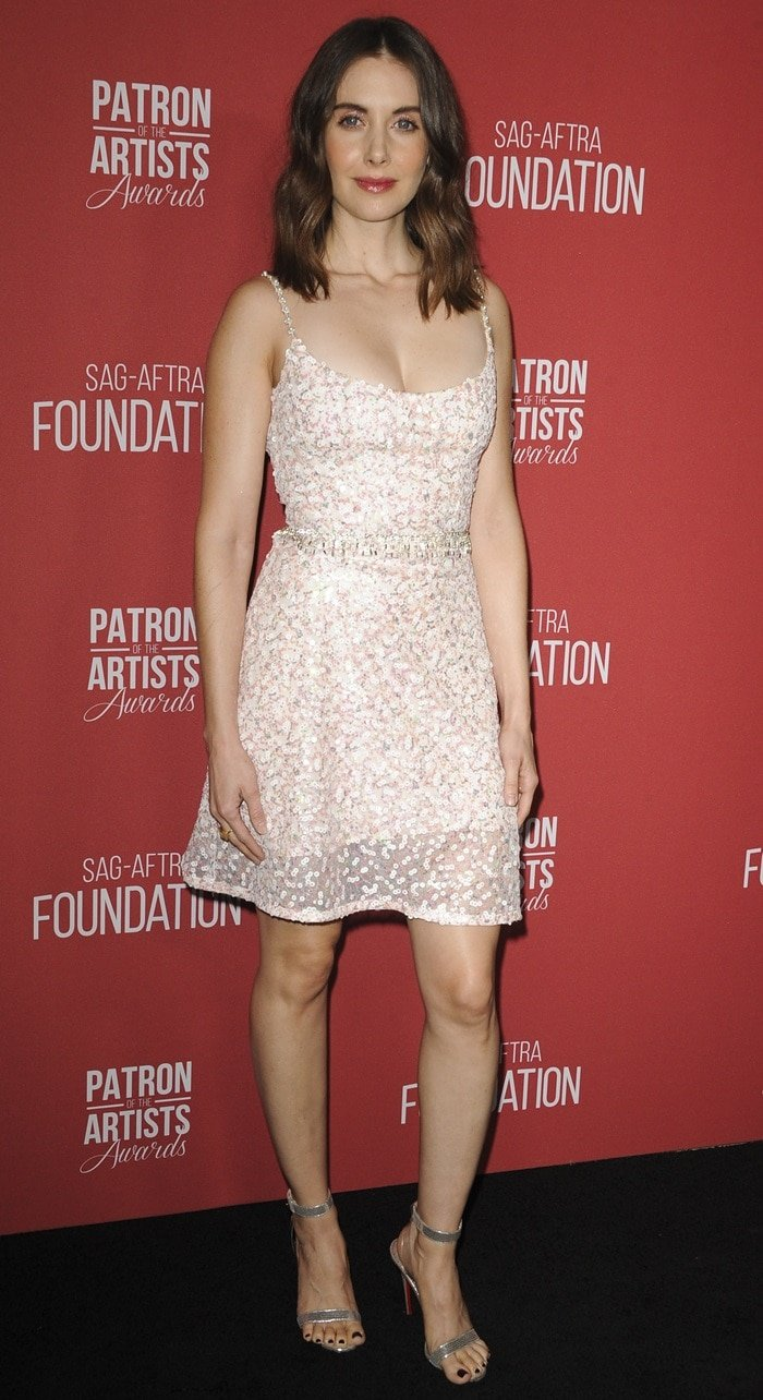 Alison Brie flaunts her legs in a sequined slip dress at the 2018 Patron of the Artists Awards