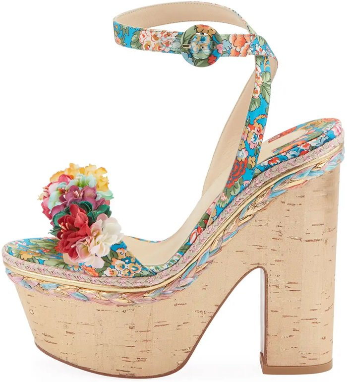 Styled with a gold cork platform and heel, these bold shoes are completed with a floral-tissue-embellished toe band