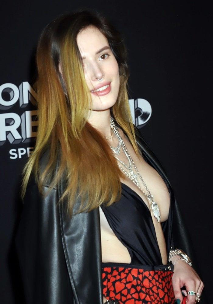 Bella Thorne's sideboob in a revealing black top