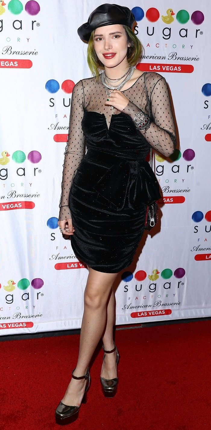 Bella Thorne flaunts her unshaven pins while attending her 21st birthday party at Sugar Factory American Brasserie in Las Vegas on October 8, 2018