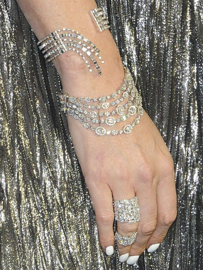 Details of the Messika 'Undine' and 'Starry Night' bracelets, 'Miss Milla' double ring, and 'Move' ring worn by Charlize Theron