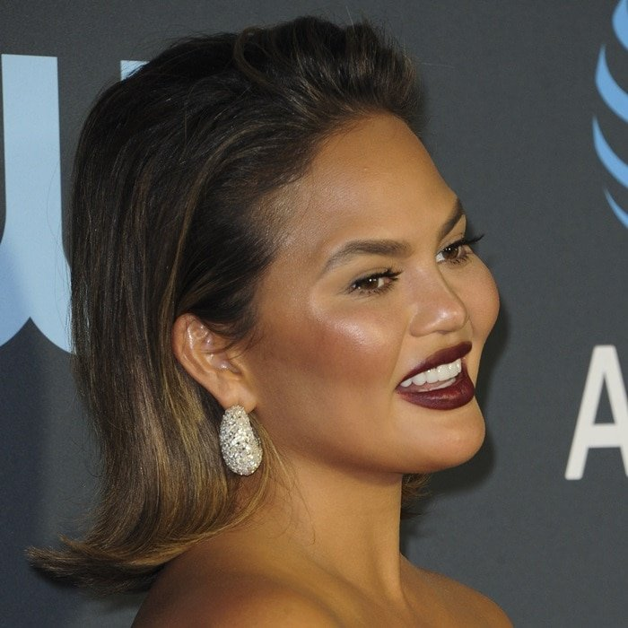 Suffering from a severe hangover, Chrissy Teigen shows off her Jaipur Gems diamond earrings
