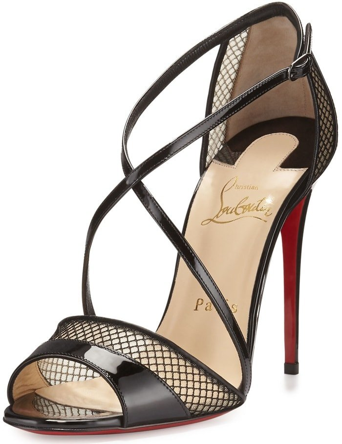 Slender calfskin leather straps interplay with peekaboo mesh on this breathtaking stiletto sandal that expertly showcases the elegant lines of your foot