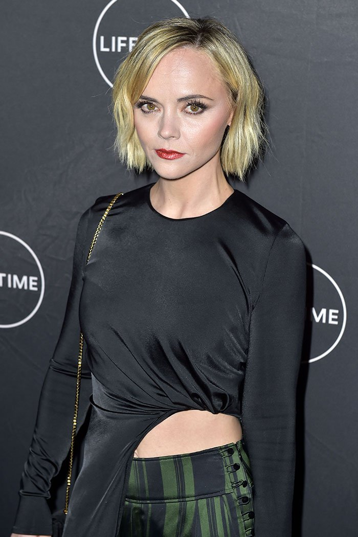Christina Ricci baring some midriff in a cutout-side, asymmetrical long-sleeved top