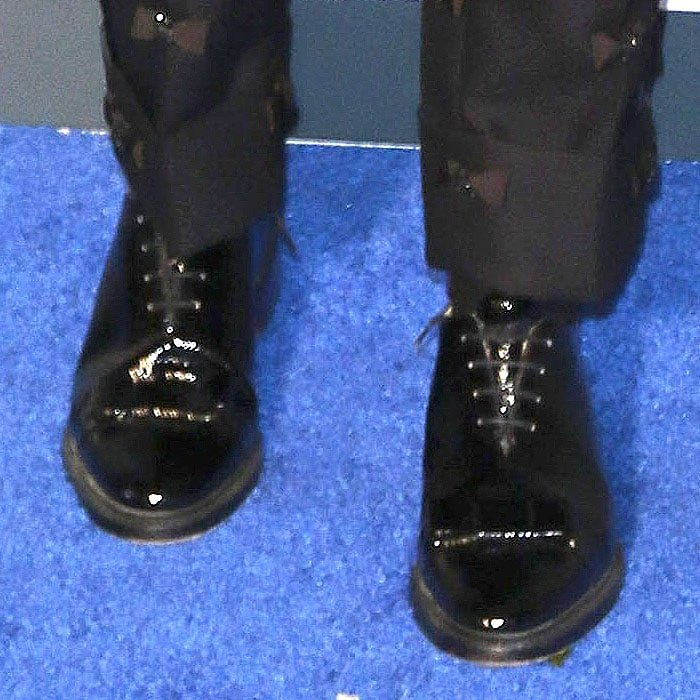Details of Elsie Fisher's Thom Browne patent-leather bow oxford shoes