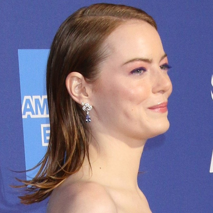 Emma Stone's hair with an off-center parting and diamond earrings