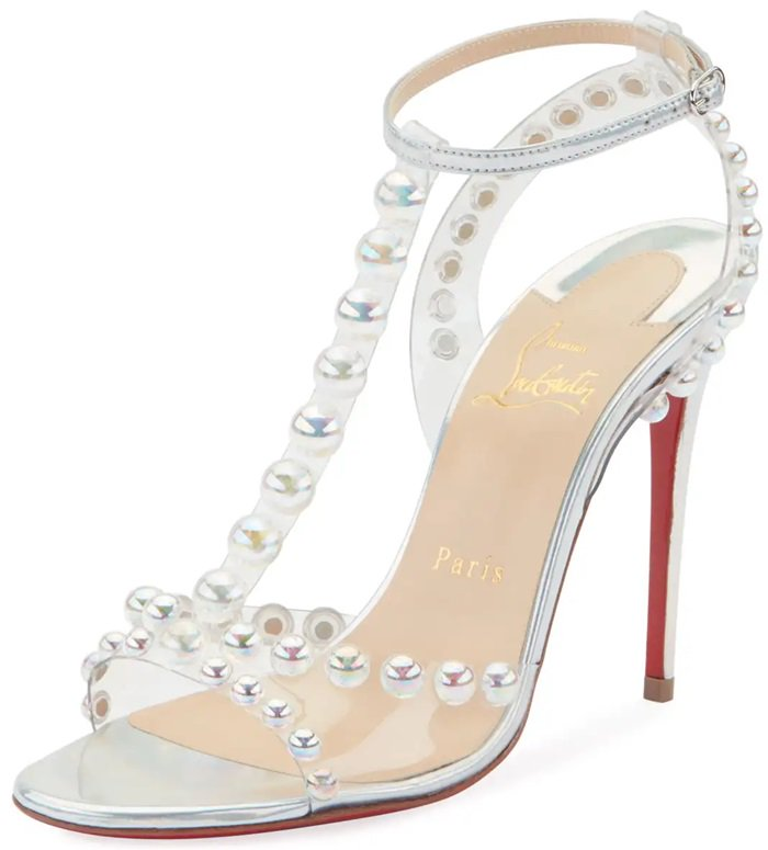 Crafted in Italy, they have clear PVC straps with pearl-like bubble bead embellishments, a buckled ankle strap and the label's signature red leather sole