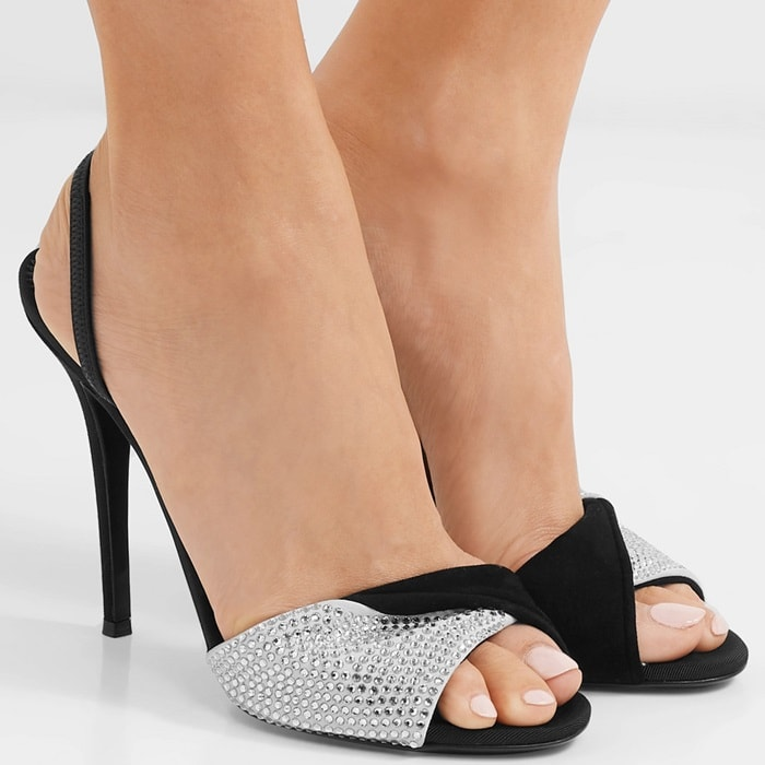This sandal is set on an extra tall stiletto heel with suede straps and shimmering crystals embellishments