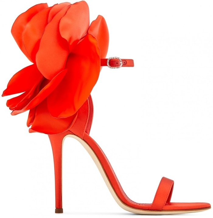 These sandals are made from red satin and are set on a stiletto heel and fasten with an ankle strap