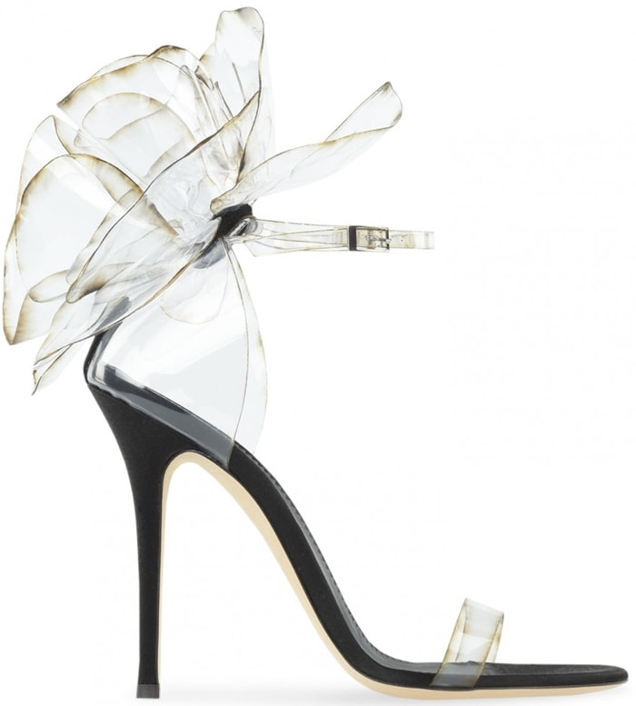 These couture sandals are made from transparent vinyl with inserts in black satin and suede
