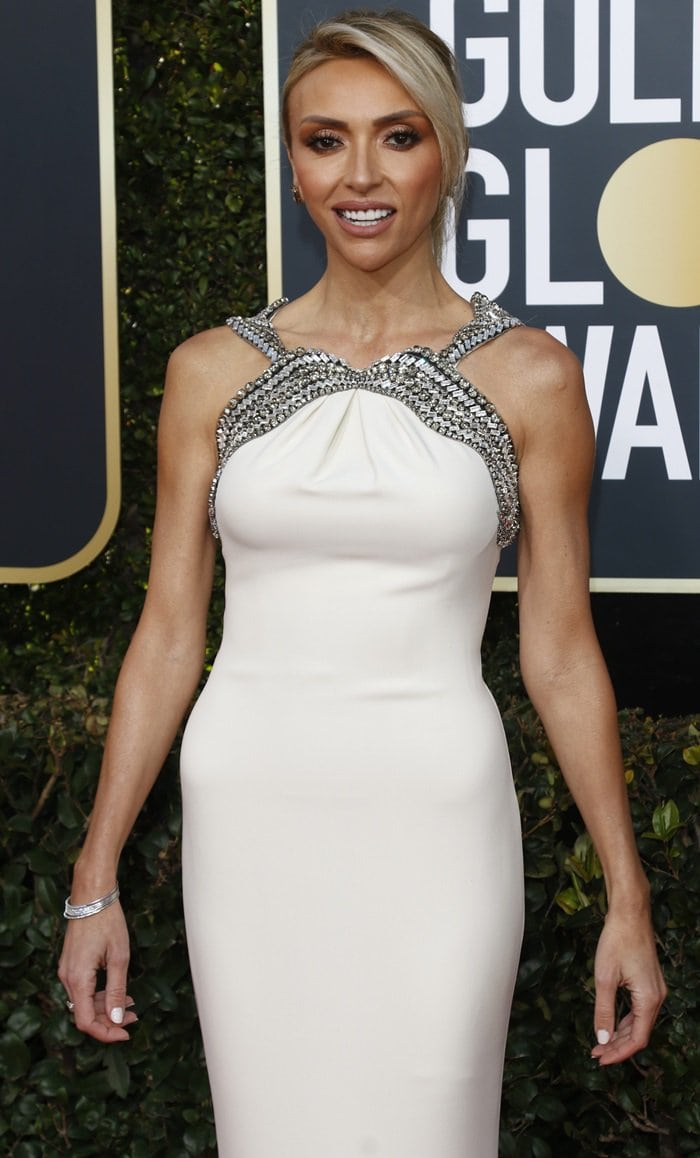 Giuliana Rancic pulled her blonde hair behind her head into an intricate half bun on the red carpet at the 2019 Golden Globe Awards
