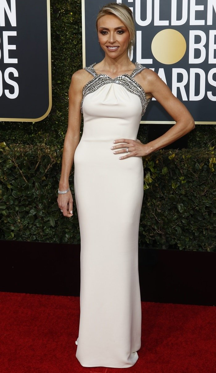 Giuliana Rancic looked incrediblein a cream-colored floor-length gown from Gucci