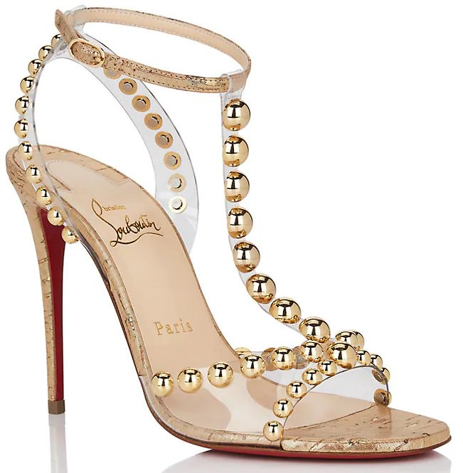 Styled with a leg-lengthening stiletto heel, these sandals are constructed in Italy of gold metallic cork and clear PVC