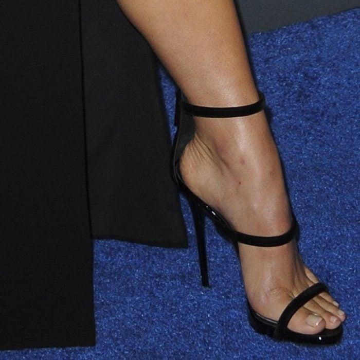 Haley Lu Richardson's nude feet inblack Harmony Velvet sandals from Giuseppe Zanotti
