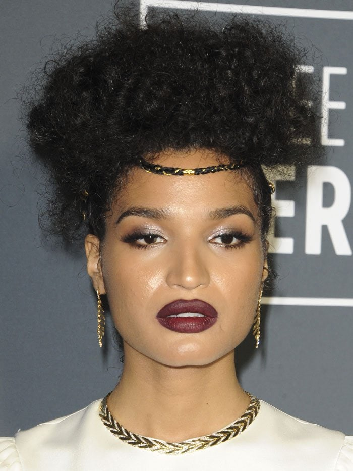 Indya Moore wearing a braided hairpiece and jewelry pieces from Hueb, Marco Bicego, and John Hardy