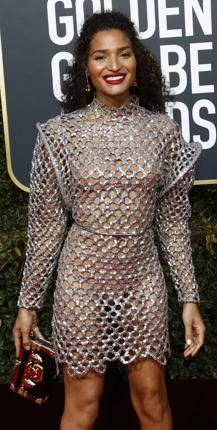 Indya Moore with visible underwear in a revealing Louis Vuitton dress