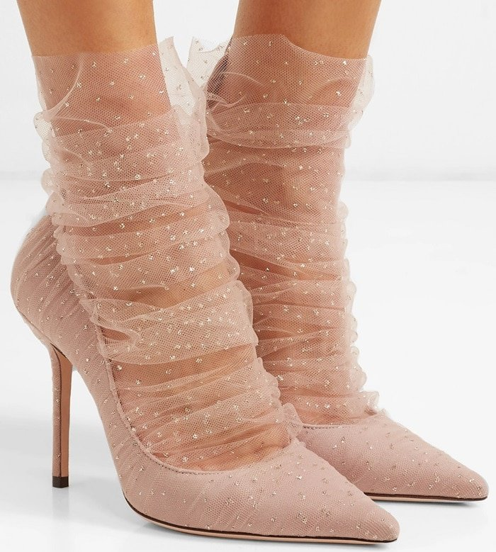Nodding to the '80s, this blush pair is set on 100mm stiletto heels and has been made in Italy from suede which is accented with a ruched tulle veil dotted with shimmering gold glitter