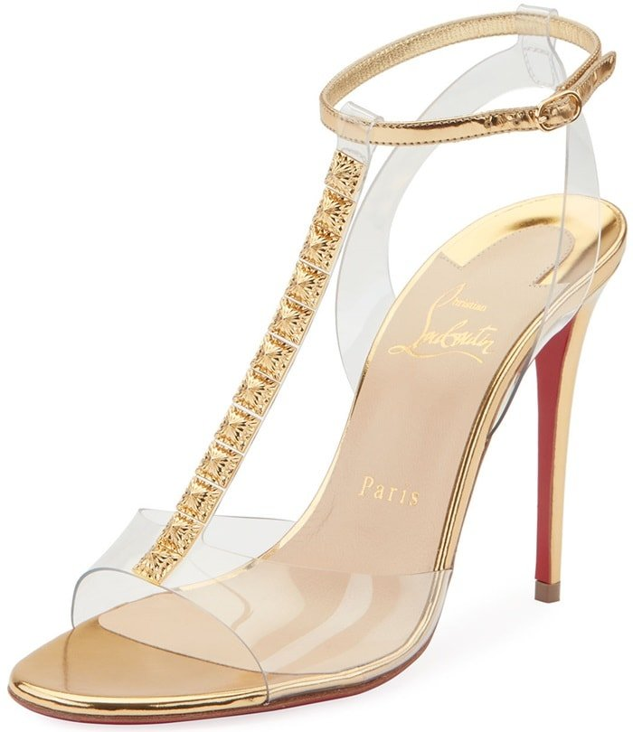 On-trend PVC sandals with high-shine leather accents adorned with faceted metallic T-strap trim.