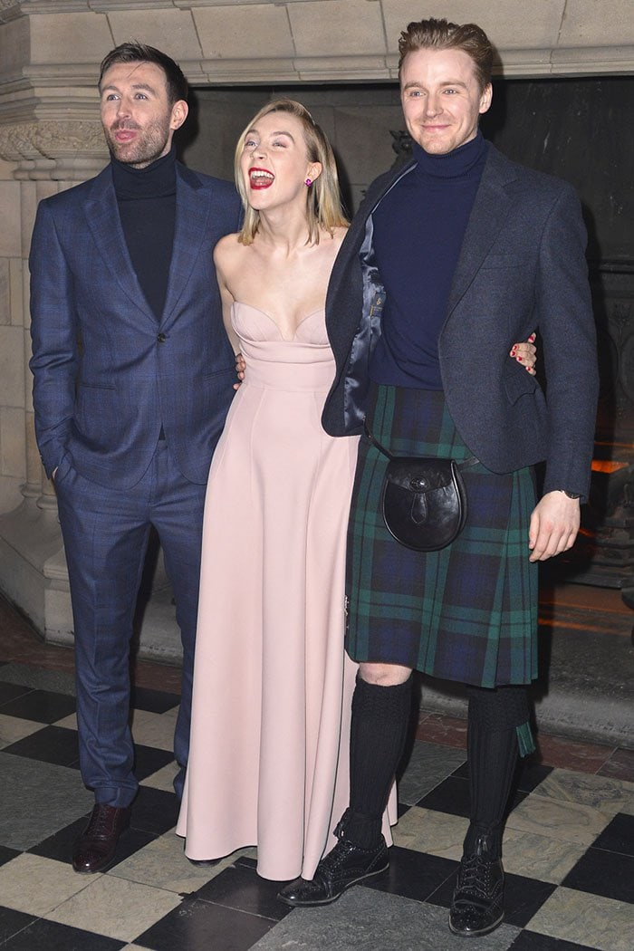 """Saoirse Ronan flanked by her tartan-clad """"Mary Queen of Scots"""" co-stars, James McCardle and Jack Lowden"""
