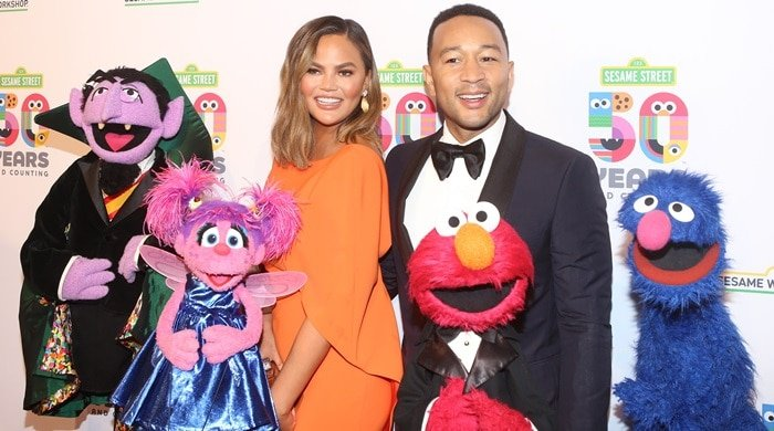 Chrissy Teigen and John Legend posed with Sesame Street characters at the Sesame Street 50th Anniversary Benefit Gala