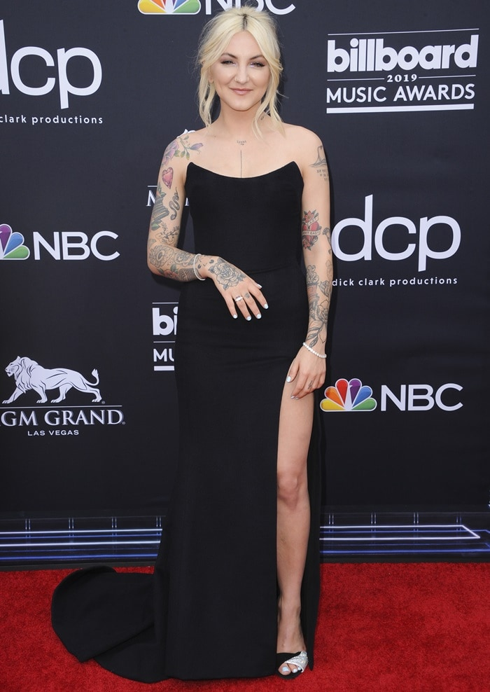Julia Michaels in crystal-embellished suede slingback sandals by Giuseppe Zanotti