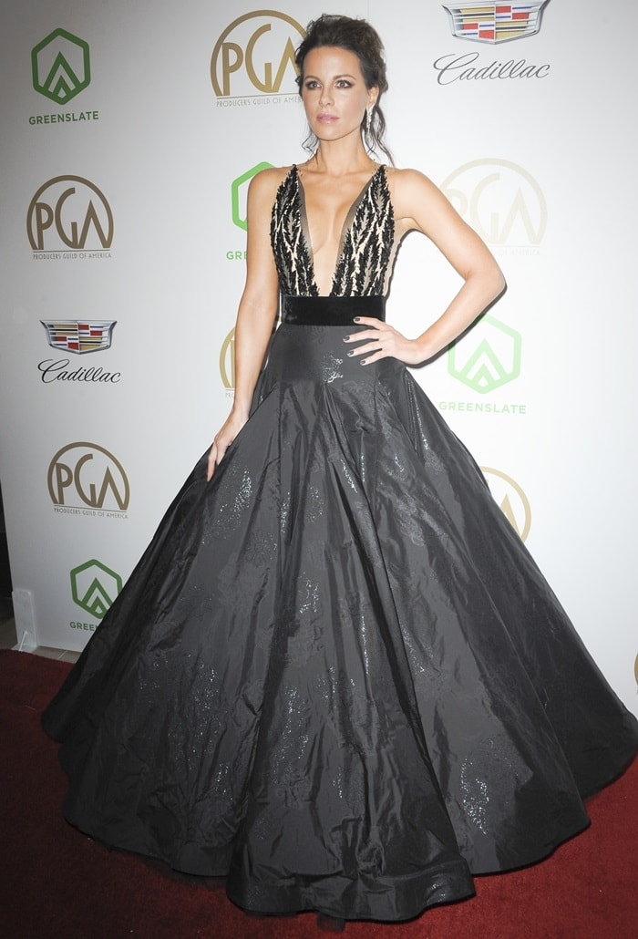 Kate Beckinsale strikes a pose in a Yanina Couture gown on the red carpet as she arrives at the 2019 Producers Guild Awards at the Beverly Hilton Hotel in Beverly Hills, California, on January 19, 2019