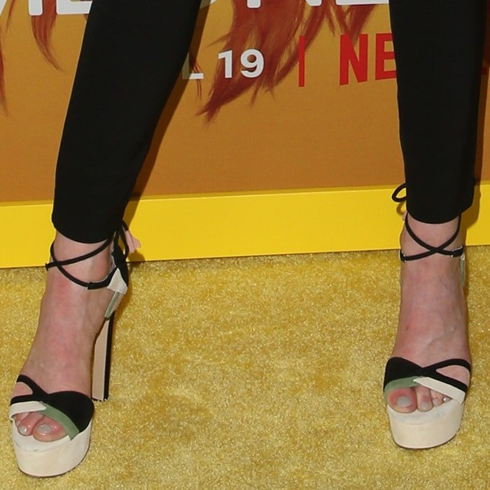 Katherine McNamara's big toes in Friend of the Forest sandals from Ruthie Davis x Disney