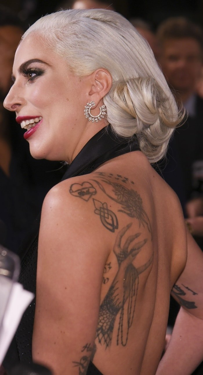 Lady Gaga's huge hand-turned-monster paw tattoo on her left back