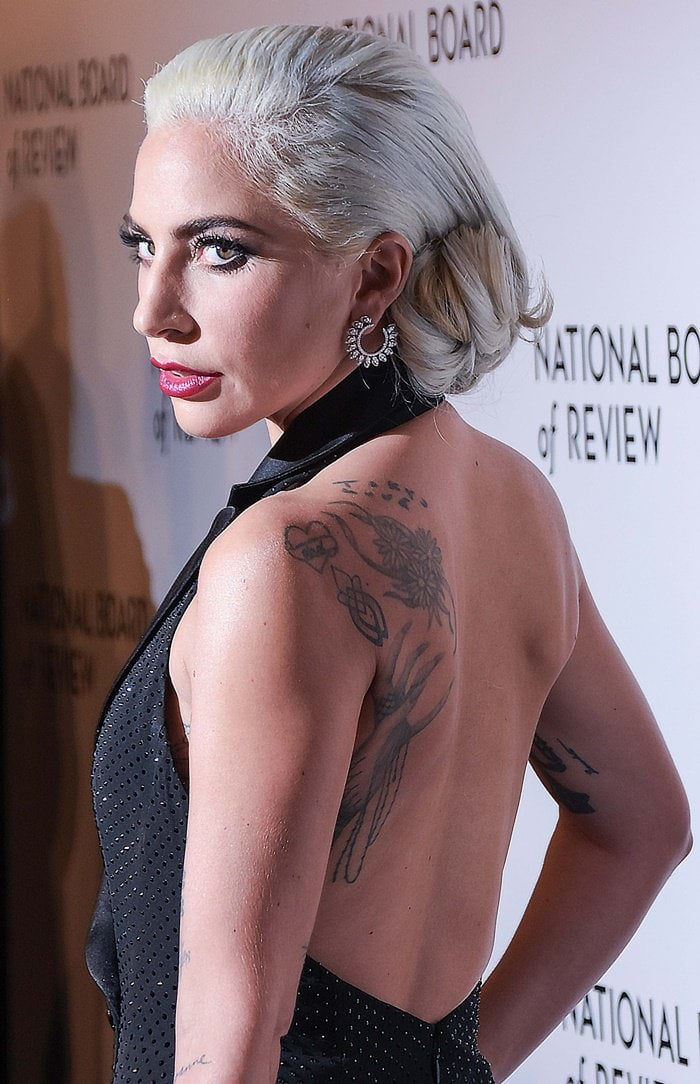 Lady Gaga showed off her back tattoos in a sleeveless black tuxedo dress