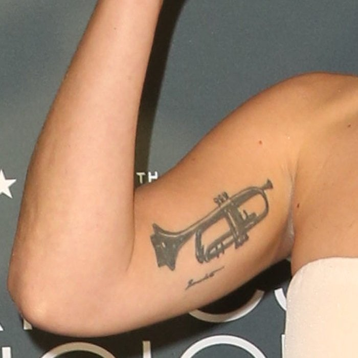 Lady Gaga's trumpet arm tattoo in honor of jazz musician Tony Bennett