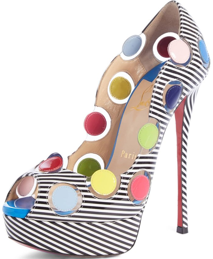 Clear-disc insets frame floating color-pop polka dots on a whimsical platform pump lifted by a soaring stiletto and thick platform