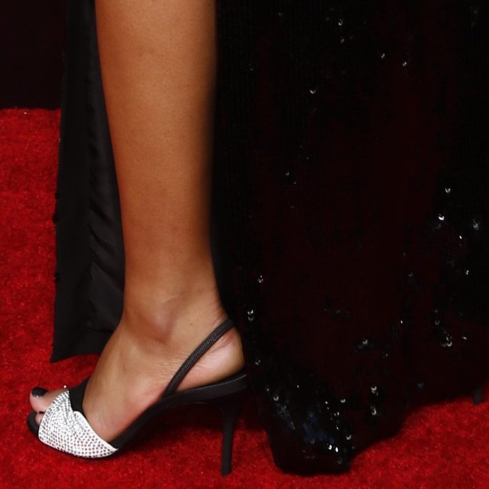 Laura Harrier's black and white suede Rosaline sandals with crystal embellishment