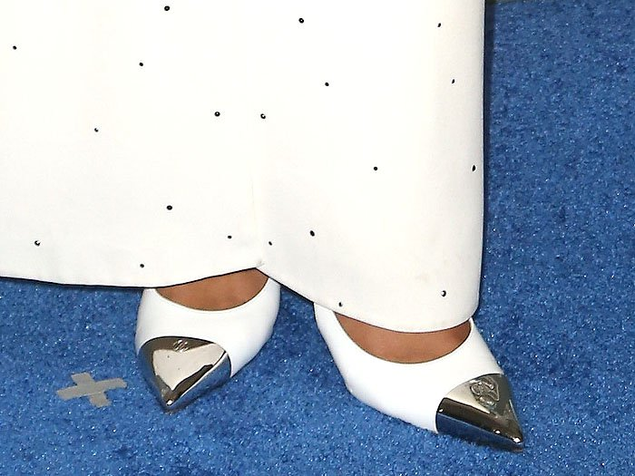 Details of Laura Harrier's Louis Vuitton 'Merry Go Round' white-leather pumps with silver pointy cap-toes