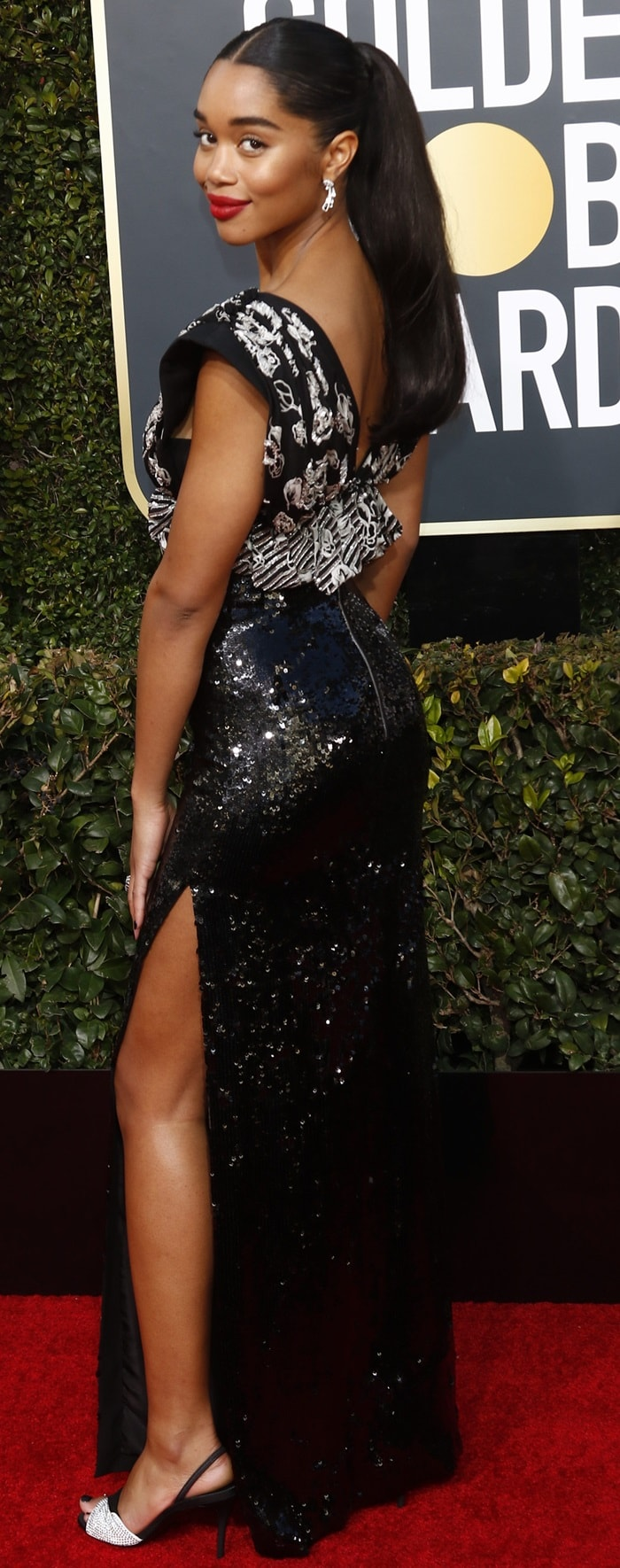 Laura Harrier flaunts her legs on the red carpet at the 2019 Golden Globe Awards at the Beverly Hilton Hotel in Beverly Hills, California, on January 6, 2019