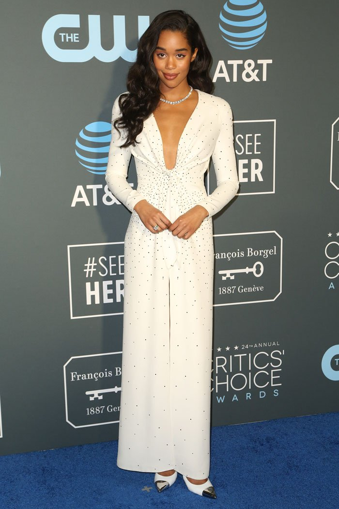 Laura Harrier in a Louis Vuitton Pre-Fall 2019 embellished white long-sleeved gown and Louis Vuitton 'Merry Go Round' white cap-toe pumps