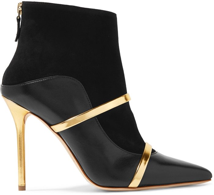 These pointy-toe ankle boots are made from supple black suede and tonal leather to emulate the brand's signature cutaway silhouette