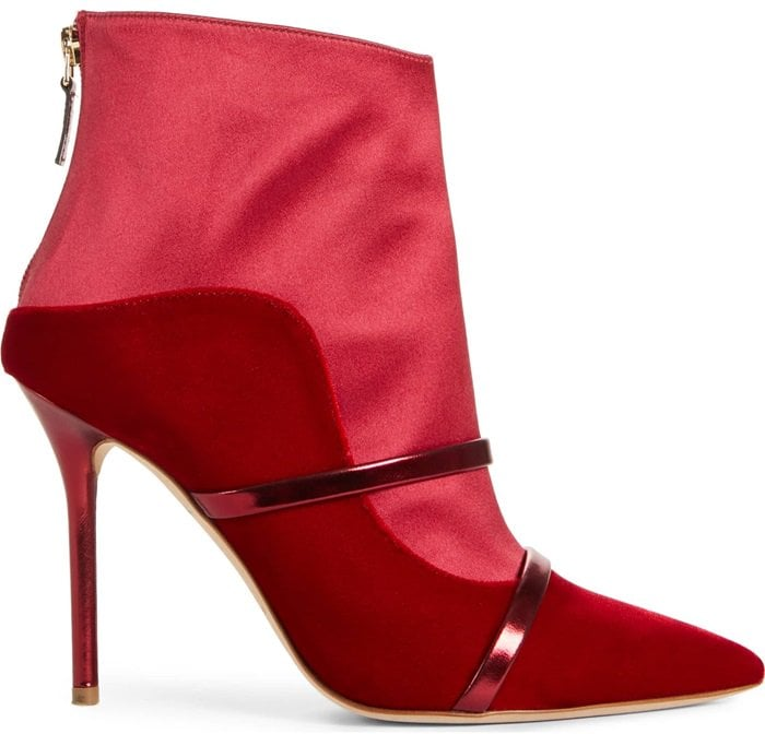 Slender leather bands highlight the bold design of a red velvet pointy-toe boot that's a fabulously chic take on a signature look
