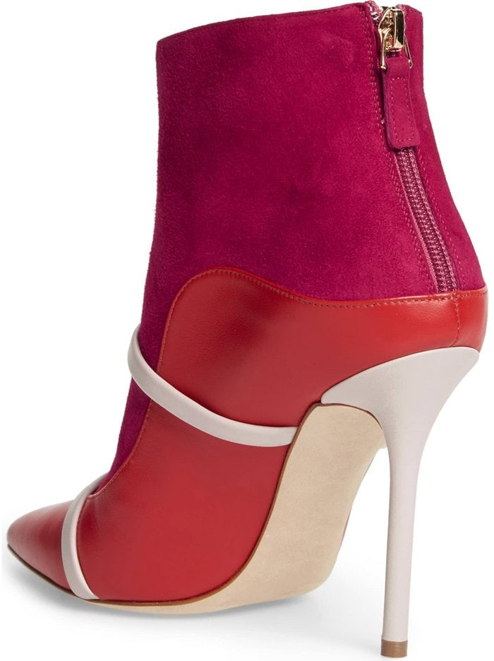 Slender leather bands highlight the bold design of a pointy-toe boot that's a fabulously chic take on a signature look