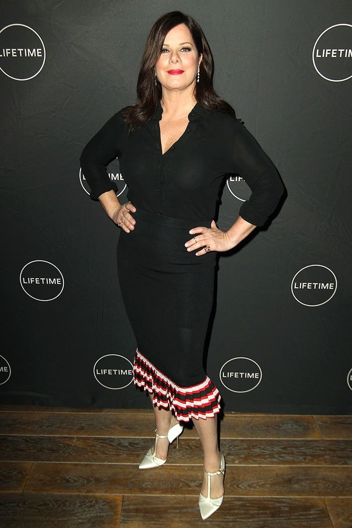 Marcia Gay Harden wearing a Sachin & Babi shirt and striped-ruffle-hem skirt with Monica Vinader jewelry and Malone Souliers 'Imogen' white-satin t-strap pumps