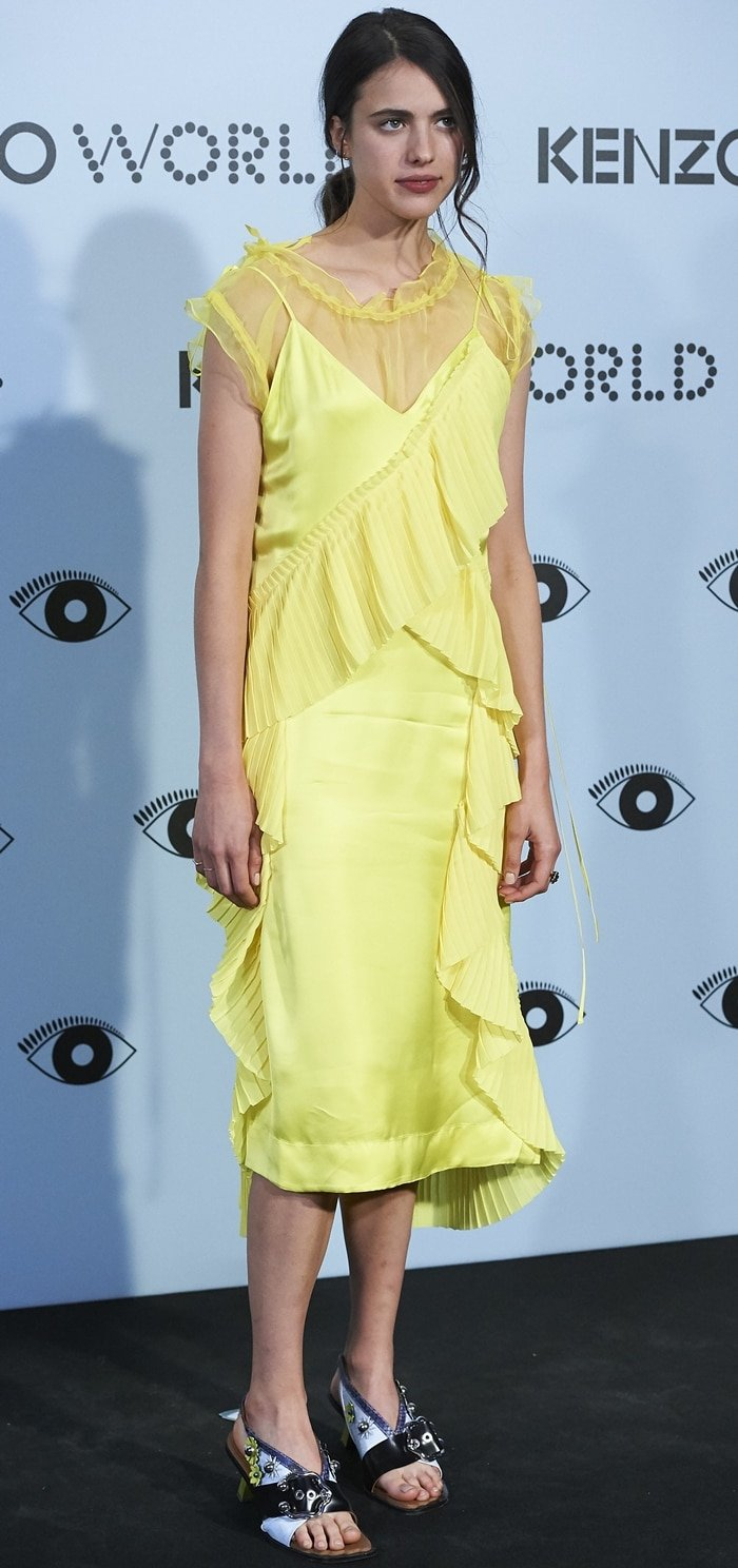 Margaret Qualley flaunted her legs in a yellow dress at the Kenzo Summer Party