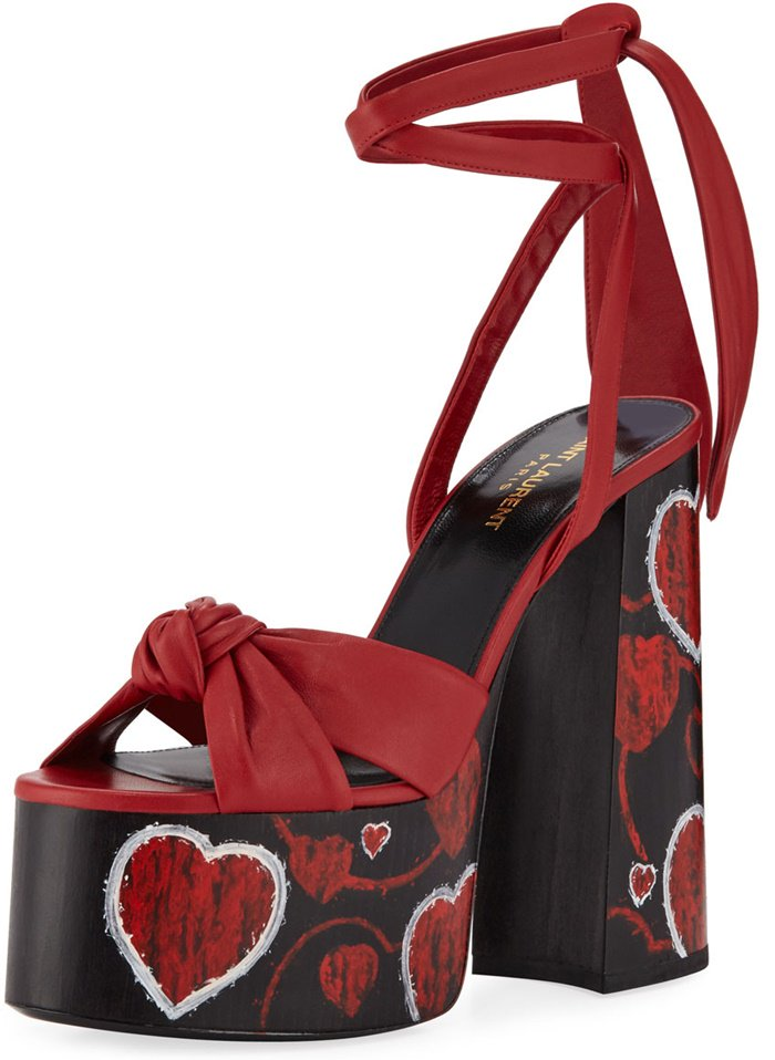 These sandals sit on an ultra-high platform and block heel and have a knotted front strap, then secure with slender ankle ties