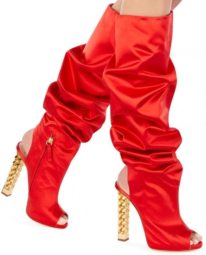 Sleek peep toe boots with an iconic cylindric textured heel
