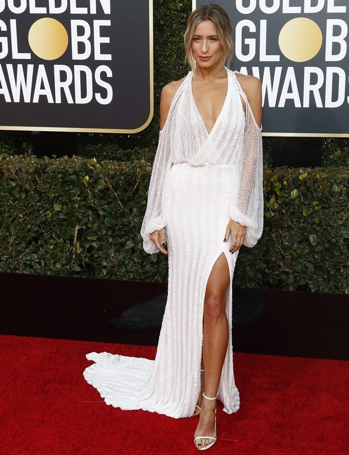 Renée Bargh flaunts her toned legs in a custom embellished dress by Sydney-based bridal designer J. Andreatta on the red carpet at the 2019 Golden Globe Awards at the Beverly Hilton Hotel in Beverly Hills, California, on January 6, 2019