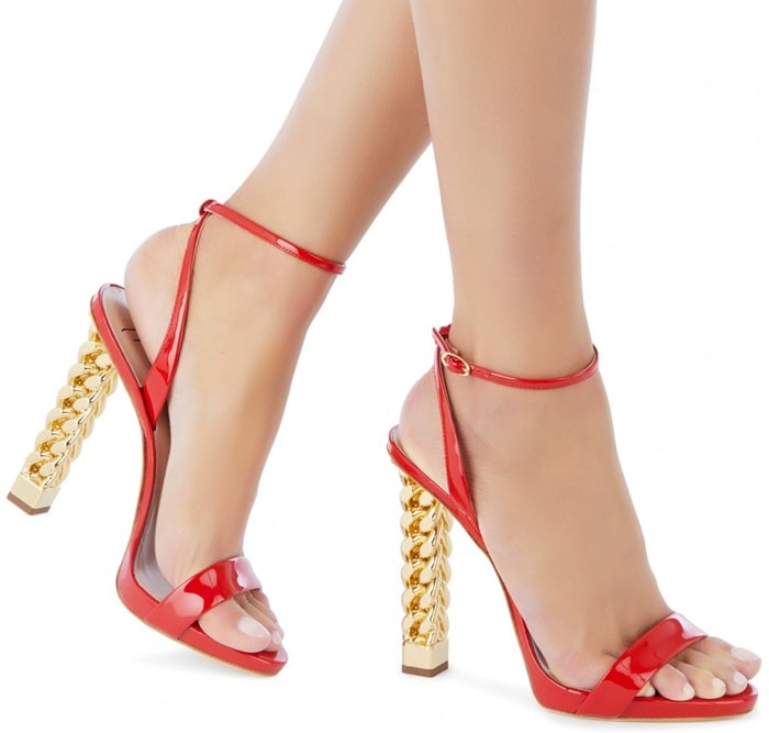 """Crafted from luxurious poppy red patent leather, these sandals are set on the iconic """"Chain"""" chrome heel, defining element of the collection"""