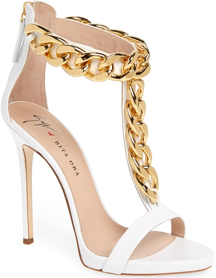 A statement-scale curb chain climbs the T-strap and rings the ankle of a daringly tall sandal crafted from optic-white calfskin