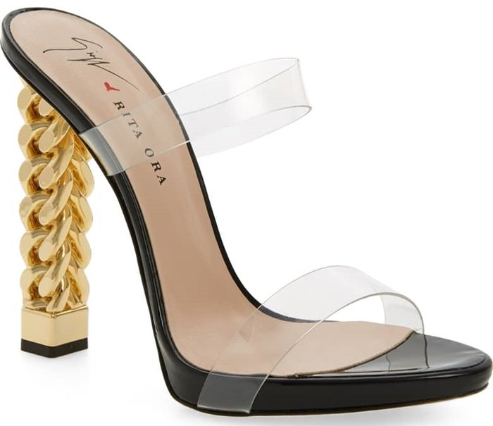 As enchanting as Cinderella's glass slipper, but much more wearable, this playful Italian sandal is styled with transparent straps and a golden curb-chain heel.