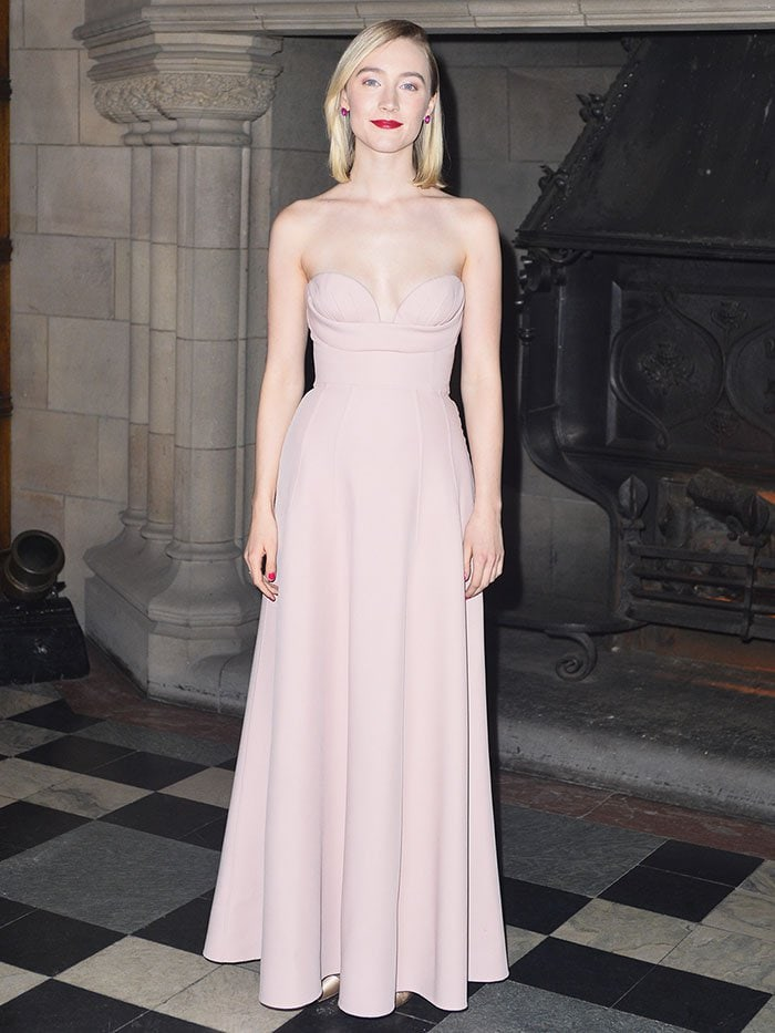Saoirse Ronan wearing a Christian Dior Fall 2018 Haute Couture soft-pink strapless dress with Christian Louboutin 'Nosy' gold-satin pumps