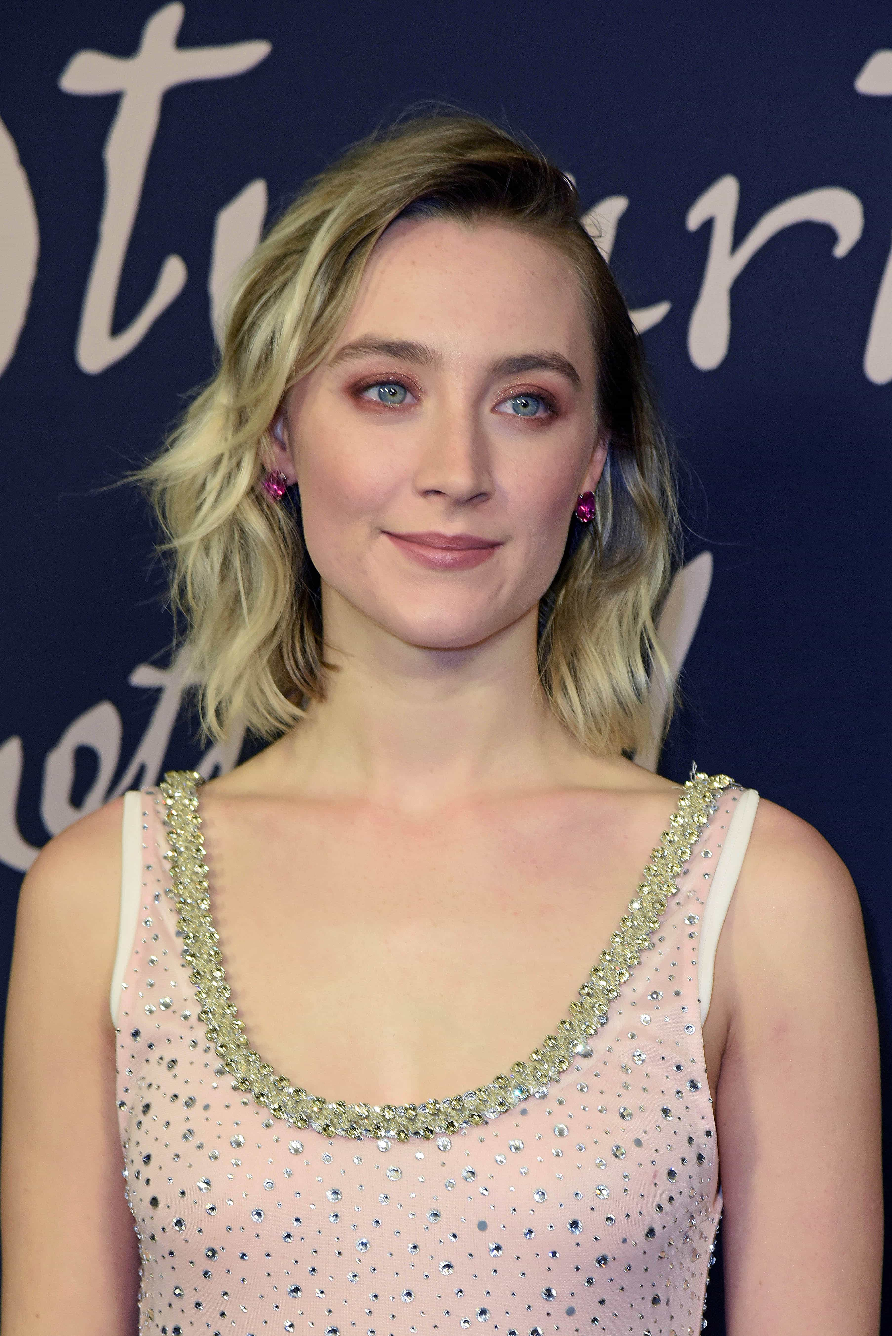 Saoirse Ronan wearing Anabela Chan pink-stone earrings with a Miu Miu crystal-embellished scoop-neck dress