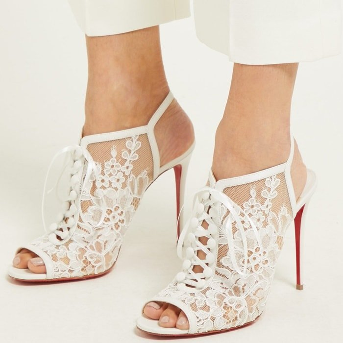 These white Mariée A Colmar sandals from Christian Louboutin encapsulate the label's alluringly glamorous aesthetic